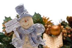 Merry Christmas Snowman. Against a tree Stock Photos