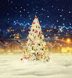 Merry christmas, snowy xmas tree with decoration Stock Photo