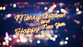 Merry christmas sparkler greeting and city lights Stock Photos