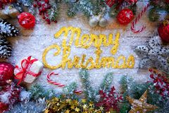 Merry Christmas spell word on white snow royalty free stock images