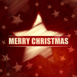 Merry Christmas in striped star symbol over red background with Stock Images