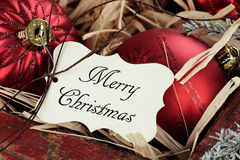 Merry Christmas Tag and Christmas Ornaments Royalty Free Stock Photography