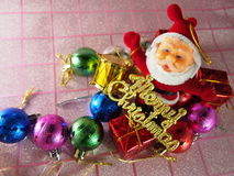 Merry Christmas tag, Santa Claus with gift box, ornament. Celebrate on December Royalty Free Stock Photo