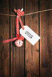 Merry Christmas tag on wooden surface Stock Image