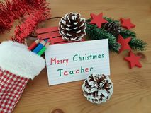 Merry Christmas Teacher, Stocking With Colored Pencils, Pine Cone And Sled royalty free stock photos