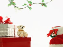 Merry christmas, teddy. Teddy bear, christmas boot, and present Royalty Free Stock Photo