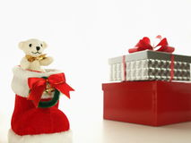 Merry christmas, teddy. Teddy bear, christmas boot, and present Royalty Free Stock Photos