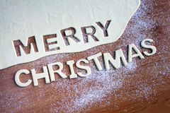 Merry Christmas text, baking Christmas cookies Royalty Free Stock Photography