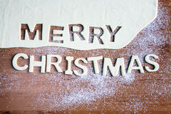 Merry Christmas text, baking Christmas cookies Stock Images