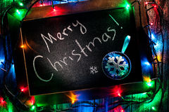 Merry Christmas text on board Royalty Free Stock Photo