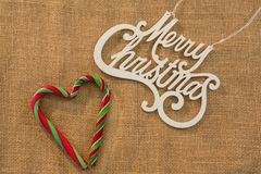 Merry Christmas text with candy canes Stock Photos