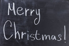 Merry Christmas text on chalkboard Stock Photo