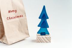 Merry christmas text on craft present and xmas tree toy with eco Royalty Free Stock Photography