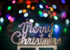 Merry Christmas text decoration with colored light spots. Merry Christmas text decoration on a table with colored light spots Stock Images