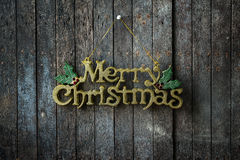 Merry Christmas text design on the Wooden Wall Royalty Free Stock Image