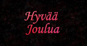 Merry Christmas text in Finnish Hyvaa joulua formed from dust and turns to dust horizontally stock video footage