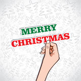 Merry christmas text in hand Royalty Free Stock Photography