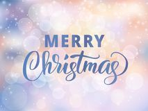 Merry Christmas text. Holiday greetings quote. Blurred winter background with falling snow effect. Merry Christmas text, hand drawn letters. Holiday greetings Royalty Free Stock Image
