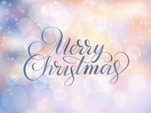 Merry Christmas text. Holiday greetings quote. Blurred winter background with falling snow effect. Merry Christmas text, hand drawn letters. Holiday greetings Stock Photos