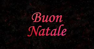 Merry Christmas text in Italian Buon Natale formed from dust and turns to dust horizontally stock video