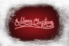 Merry Christmas text on red background and hoarfrost snow frost on xmas window. Pattern copy space Stock Photos