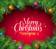 Merry christmas text in a red background with pine leaves boarder and frame Royalty Free Stock Photos