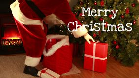 Merry Christmas text and Santa dressed beautiful woman opening gift