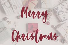 Merry christmas text, seasonal greetings card sign. flat lay. st Royalty Free Stock Images