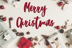 Merry christmas text, seasonal greetings card sign. wrapped pres Royalty Free Stock Photography