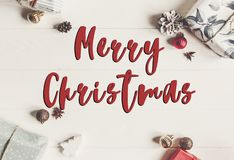Merry christmas text, seasonal greetings card sign. wrapped pres Stock Images