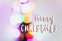 Merry christmas text sign on colorful lights. bright bokeh. magi stock photo