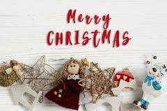 Merry christmas text sign on  frame of golden toys. ornament bor Stock Photos