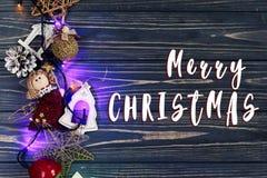 Merry christmas text sign on  garland lights border ang toys on Royalty Free Stock Photo