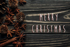 Merry christmas text sign greeting on  wooden background, stylis Royalty Free Stock Photo