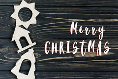 Merry christmas text sign on simple christmas eco toys on stylis. H black wooden background in border line. space for text. holiday greeting card concept Stock Photos