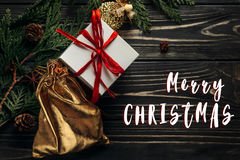 Merry christmas text sign on stylish  flat lay presents with red Stock Image