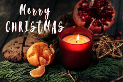 Free Merry Christmas Text Sign With Candle Garnet Cookies Fruits On S Royalty Free Stock Photos - 98805718