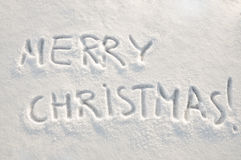 Merry christmas  text on snow. Written words Merry christmas  on a snow field, new year concept Stock Photos