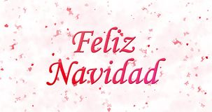 Merry Christmas text in Spanish Feliz Navidad formed from dust and turns to dust horizontally stock video