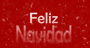 Merry Christmas text in Spanish Feliz Navidad turns to dust fr Royalty Free Stock Image