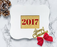 Merry christmas 2017 text in vintage white picture frame with pi Stock Photography