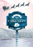 Merry Christmas text on Wooden signpost in Christmas Winter landscape and Santa`s sleigh and reindee. Digital composite of Merry Christmas text on Wooden Stock Image