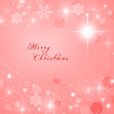 Merry Christmas text written on red Christmas sparkly bright background.  Stock Images