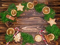 Merry Christmas text with Xmas branches over rustic wooden background