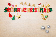 Merry Christmas theme ornaments and star lights on wood floor Royalty Free Stock Image