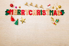 Merry Christmas theme ornaments and star lights on wood floor Royalty Free Stock Photos