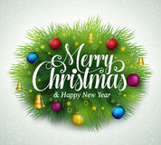 Merry christmas title in green pine leaves with decoration Stock Image