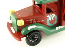 Merry christmas toy lorry. Christmas wooden toy lorry on background royalty free stock photography