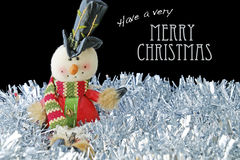 Merry Christmas with Toy Snowman on Tinsel Stock Image