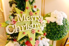 Merry Christmas. On christmas tree in home Stock Image